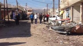 SANA photo shows a damaged area pictured after a car bomb in Qatana, near Damascus